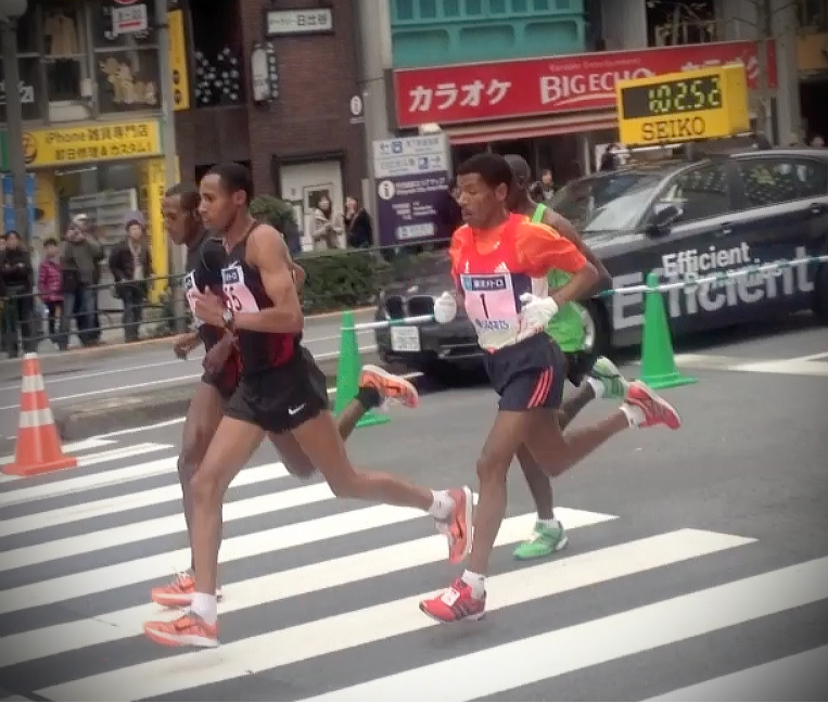 Elite runners kick high. Classic Haile Gebrselassie at Tokyo Marathon 2012 half way point.